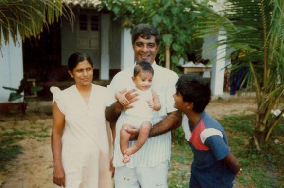 Prasanna Kirtisinghe carrying his youngest son Matheesha, with wife Padmini and elder son Kanishka at Siriniwasa, Hikkaduwa.  Modified January 18 2005. Photograph©Chulie de Silva